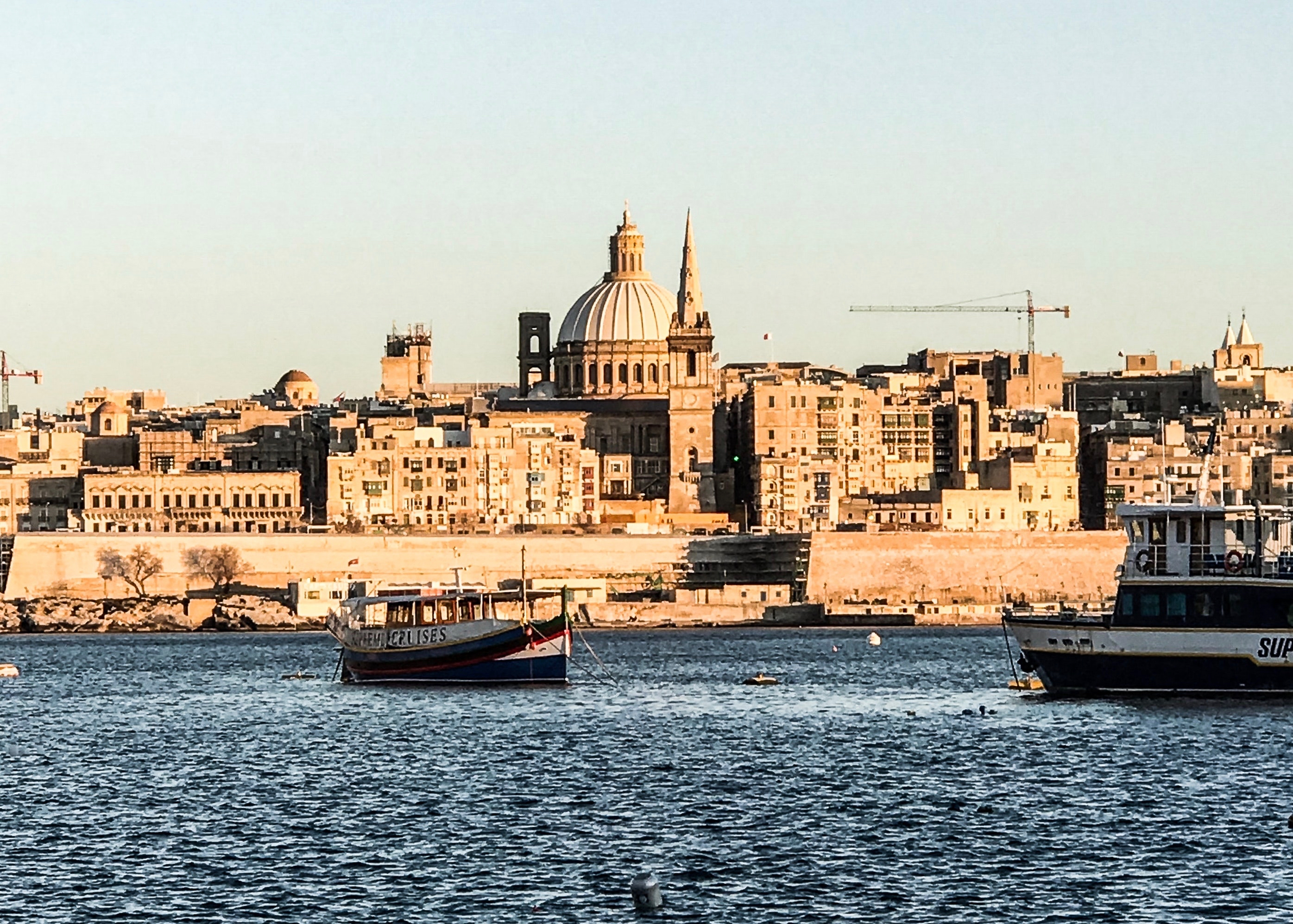 Valletta, Malta. Photo by Ines Bahr from Pexels https://www.pexels.com/photo/two-ship-on-body-of-water-near-buildings-2098179/