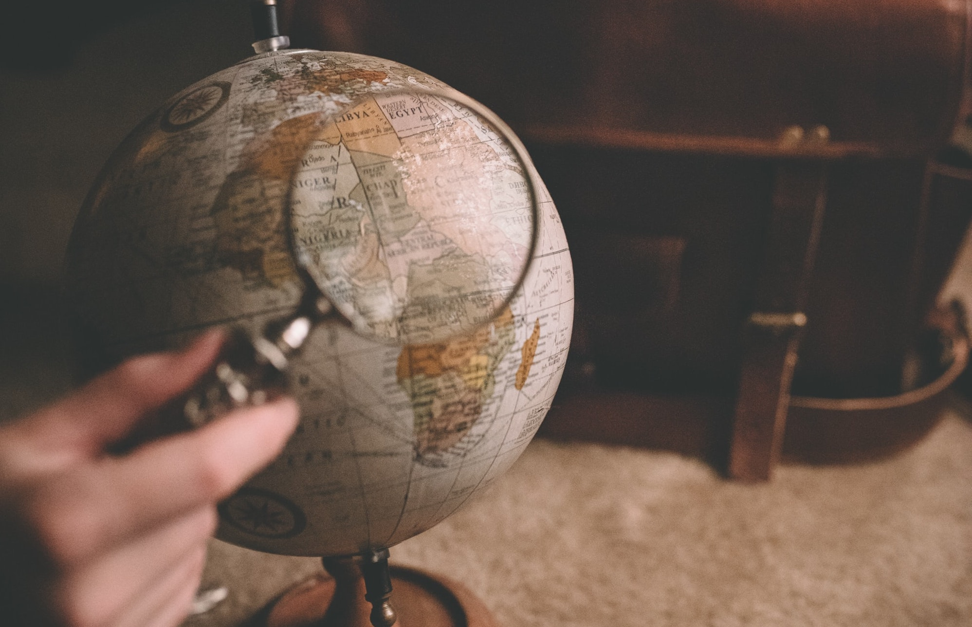 Globe and magnifying glass. Photo by Clay Banks on Unsplash.
