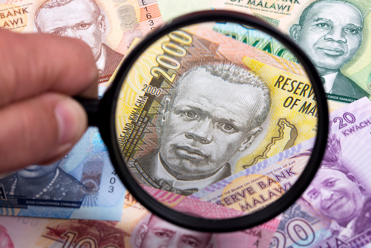 Malawi Kwacha and magnifying glass