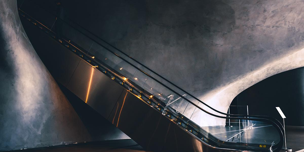 Escalator down into a dark space